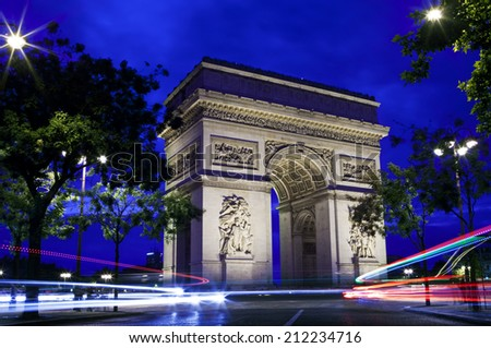 PARIS, FRANCE - AUGUST 7TH 2014: The magnificent Arc de Triomphe and light trails in Paris on 7th August 2014. - stock photo