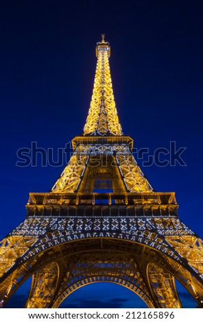 PARIS, FRANCE - AUGUST 9TH 2014: The magnificent Eiffel Tower at dusk in Paris on 9th August 2014.