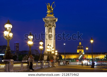 PARIS, FRANCE - AUGUST 6TH 2014: The view on Pont Alexandre III looking towards Les Invalides in Paris on 6th August 2014. - stock photo