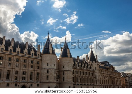 PARIS, FRANCE - AUGUST 30, 2015: The Conciergerie, located on Ile de la Cite along the river Seine in a medieval Gothic palace, is a former prison which is now a popular tourist attraction in Paris.
