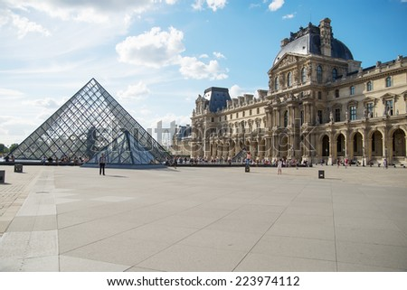 Paris, France - August 07: The Louvre Museum in Paris, France on August 07, 2013. This central landmark of Paris is one of the world's largest museums. - stock photo