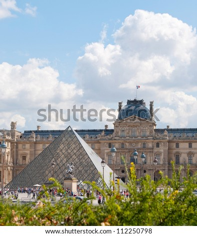 PARIS, FRANCE - AUGUST 28: The Louvre Museum on August 28, 2012. In 1682 Louis XIV define the Louvre Palace as a place for royal collection. The Museum opened after French Revolution on 10 August 1793