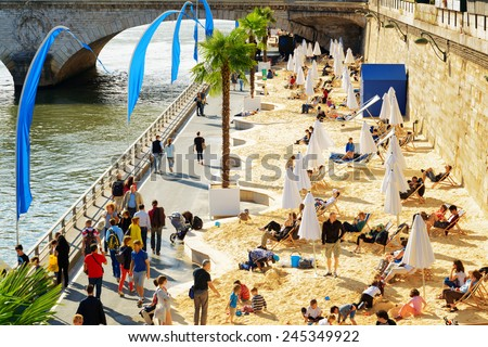 PARIS, FRANCE - AUGUST 13, 2014: The public beach on the banks of the River Seine in Paris. Paris is one of the most popular tourist destinations in Europe. - stock photo