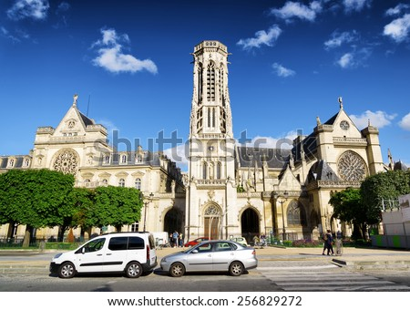 PARIS, FRANCE - AUGUST 13, 2014: The western facade of the catholic church of Saint Germain of Auxerre in Paris. Paris is one of the most popular tourist destinations in Europe. - stock photo