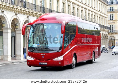 PARIS, FRANCE - AUGUST 8, 2014: Touristic coach Irizar PB at the city street. - stock photo