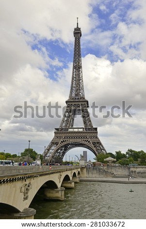 PARIS FRANCE. CIRCA MAY 2015. Due to increase activity of pickpocket gangs targeting tourists and visitors, the Eiffel Tower recently shut down in an effort to get a stronger police presence on scene. - stock photo