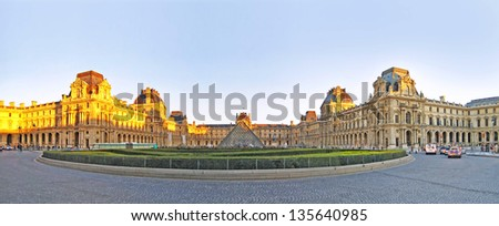 PARIS, FRANCE, -DEC 24: panorama of the kings palace louvre with its famous pyramid on December 24, 2012. Louvre is the biggest Museum in Paris displayed over 60,000 sq.M. of exhibition space.