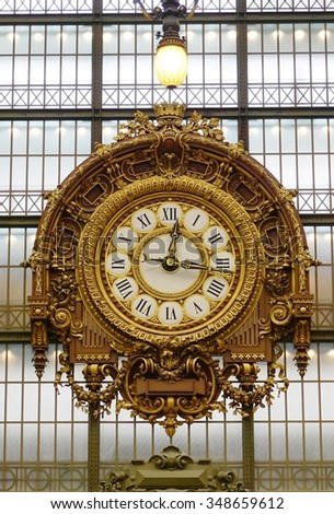 PARIS, FRANCE -5 DEC 2014- The giant clock at the Musee d'Orsay. Located in the former Gare d Orsay train station, the museum has the largest collection of impressionist paintings in the world. - stock photo