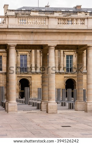 PARIS, FRANCE - DECEMBER 24, 2014: Columns Buren (1985) in the courtyard of the Palais-Royal Palace. Palais-Royal (originally - Palais-Cardinal, 1639) was personal residence of Cardinal Richelieu.