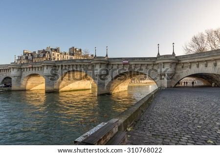 Paris, France - December 20: Pont Neuf, the oldest standing bridge across the river Seine in Paris France; viewed from the west, on December 20, 2013.