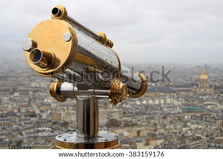 PARIS, FRANCE -16 DECEMBER 2011: Spyglass and a view from Eiffel Tower