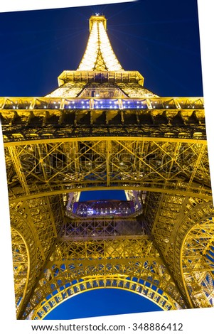 Paris; France-December 07, 2015 : The Eiffel tower is a lattice tower on the Champ de Mars in Paris, France.The tower is the tallest structure in Paris and the most visited monument in the world. - stock photo