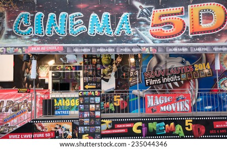 "PARIS, FRANCE - DECEMBER 3, 2014: The front of a 5d cinema theater in the traditional Christmas markets of the Champs Elysees ""Marche de noel des champs elysees""."