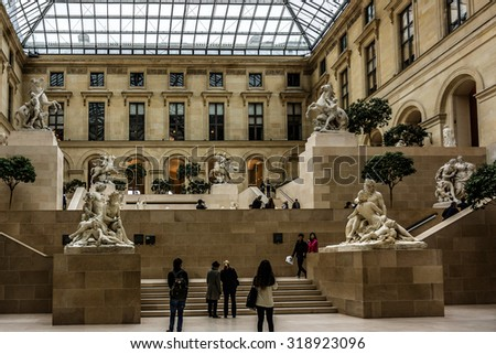 PARIS, FRANCE - DECEMBER 22, 2014: Tourists visit sculpture gallery in Louvre Museum. Louvre Museum is one of the largest and most visited museums worldwide. - stock photo