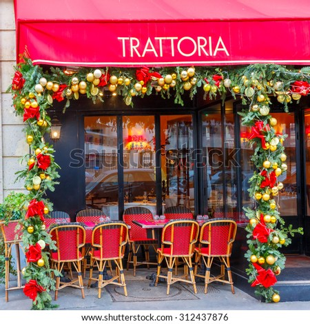 Paris, France - December 21, 2015: Trattoria Dell Angelo, an Italian restaurant near the Eiffel Tower, in a Christmas decoration - stock photo