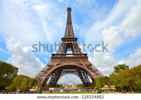 Paris, France - Eiffel Tower seen from Champ de Mars. UNESCO World Heritage Site. - stock photo