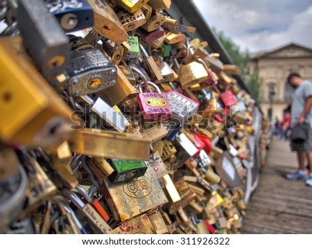Paris, France, Europe - June 21, 2013: love locks on â??Pont des Artsâ? bridge in Paris, France.  - stock photo