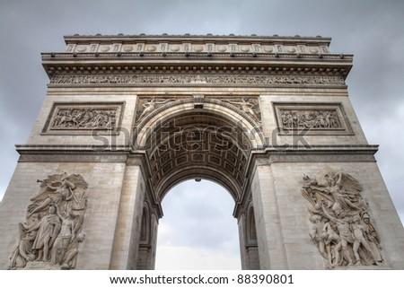 Paris, France - famous Triumphal Arch (Arc de Triomphe) located at the end of Champs-Elysees street. UNESCO World Heritage Site. - stock photo
