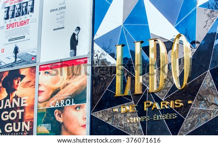 PARIS, FRANCE - FEBRUARY, 06, 2016: Detail of billboard displaying movies shown at the Lido cinema on Champs Elysees, Paris, France - stock photo