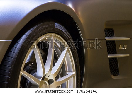 PARIS, FRANCE - FEBRUARY 20, 2014: Detail of the Mercedes SLS AMG in the iconic stars showroom on the Champs Elysees in Paris, France, on February 20, 2014