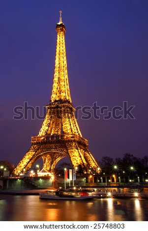 PARIS, FRANCE, 2 FEBRUARY, 2009: Eiffel tower of Paris lit at twilight. The Eiffel tower is the most visited monument of France. - stock photo