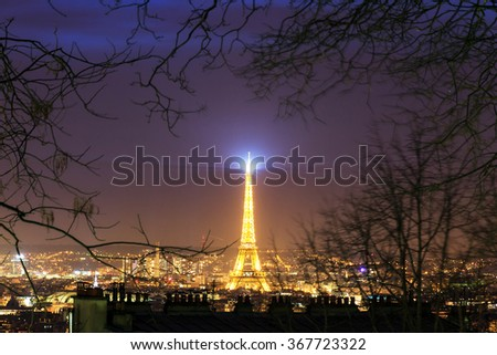 PARIS, FRANCE - FEBRUARY 23, 2014: Paris night cityscape with the illuminated Eiffel tower seen from Montmartre in winter in Paris, France, on February 23, 2014 - stock photo