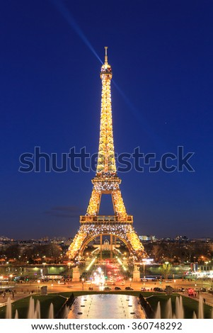 PARIS, FRANCE - FEBRUARY 21, 2014: The Eiffel tower at night seen from the Trocadero square in Paris, France, at February 21, 2014