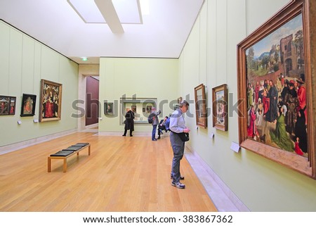Paris, France, February 10, 2016: visitors look at the pictures in Louvre, Paris, France