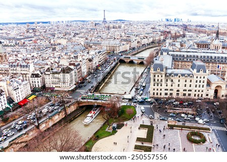 Paris, France - January 9, 2015. Aerial view (panorama) from cathedral Notre Dame on river Seine, bridges, transport, houses. Everyday lifestyle of Paris. France. Travel, transportation concept.