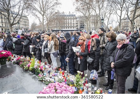 PARIS, FRANCE - January 10, 2016: ceremony place de la Republique to commemorate victims of the bombing and shooting rampage, Charlie Hebdo terrorist attack and of Marches Republicaines demonstration - stock photo