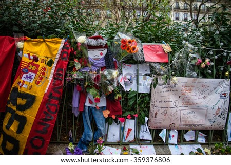 PARIS, FRANCE - JANUARY 4, 2016: Flowers and candles line the street in front of the Theater Le Bataclan for the victims of the November 13, 2015 terrorist attack in Paris, France