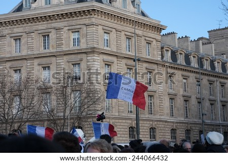 PARIS, FRANCE-JANUARY 11, 2015: French flag during manifestation on Republic Square in Paris against terrorism and in memory of the attack against satirical newspaper Charlie Hebdo.