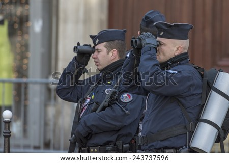 "PARIS, FRANCE - JANUARY 11, 2015 : ""Je suis Charlie"" - French Police sniper patrolling before the Republican march in Paris following the terrorist attack against the newspaper ""Charlie Hebdo"" - stock photo"