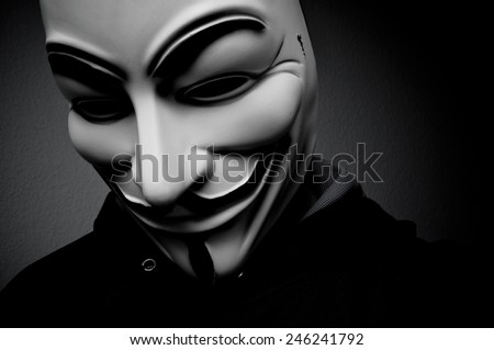 Paris - France - 18 January 2015 - man wearing Vendetta mask. This mask is a well-known symbol for the online hacktivist group Anonymous - stock photo