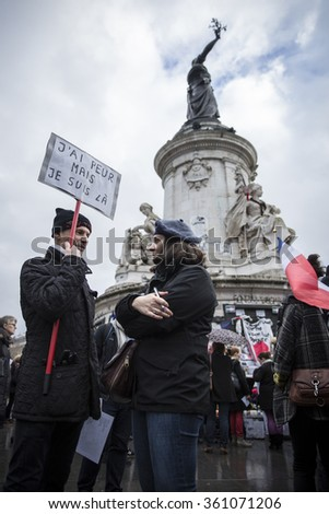 "PARIS, FRANCE- January 10, 2016: Place de la Repbublique, ceremony to commemorate victims of the bombing and shooting rampage, Charlie Hebdo terrorist attack and ""Marches Republicaines"" demonstration"