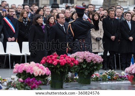 PARIS, FRANCE - JANUARY,10, 2016 :  President Francois Hollande and Anne Hidalgo filing a flower wreath to pay tribute to victims of the terrorists attacks of 2015, Charlie Hebdo and Bataclan. - stock photo