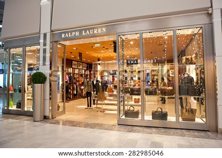 PARIS, FRANCE- JANUARY 07, 2015: Unidentified people are seen at a Ralph Lauren store; Ralph Lauren Corporation was founded in 1967, presence worldwide and a revenue of 7.45 billion USD in 2014 - stock photo