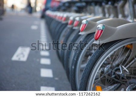 PARIS, FRANCE - JANUARY 6, 2012: Velib bicycles in the row on January 6, 2012 in Paris, France. Velib is a large-scale public bicycle sharing system in Paris, France. - stock photo