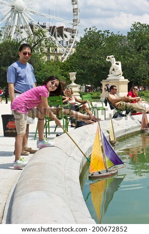 Paris, France - July 7, 2011 - Both Parisians and tourists enjoy a sunny afternoon at the Tuileries Garden (Jardin des Tuileries) in Paris.