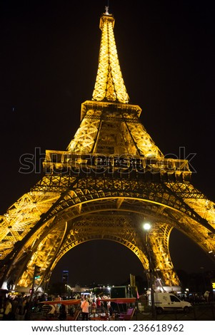 PARIS, FRANCE - JULY 14 2014: Eiffel Tower at night is the most visited monument in France and the most famous symbol of Paris, July 14, 2014
