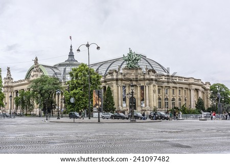 PARIS, FRANCE - JULY 13, 2012: Grand Palais des Champs-Elysees. Grand Palais in Beaux-Arts architecture style was built for Universal Exposition of 1900 and made of glass, iron, steel and concrete. - stock photo