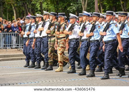 PARIS, FRANCE - JULY 14, 2014: Military parade of National Gendarmerie (Defile) during the ceremonial of french national day, Champs Elysee avenue. - stock photo