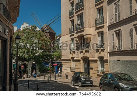 Paris, France - July 08, 2017. Old restaurant with windmill in a street of Montmartre at Paris.