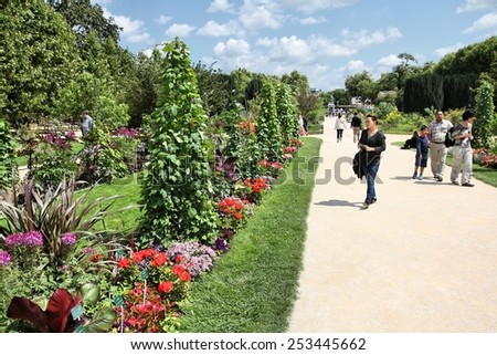 PARIS, FRANCE - JULY 24, 2011: People visit Garden of Plants in Paris, France. Garden of Plants is popular among tourists in Paris, most visited city worldwide (15.6 m international arrivals in 2011). - stock photo