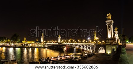 PARIS, FRANCE - JULY 14, 2014: The Eiffel Tower and Pont Alexandre III at night in Paris, France, July 14, 2014 - stock photo
