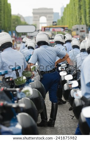 """PARIS, FRANCE - JULY 25, 2014 : The presidential escort waiting after the arrival of """"France tour"""" on Champs Elysees - stock photo"""