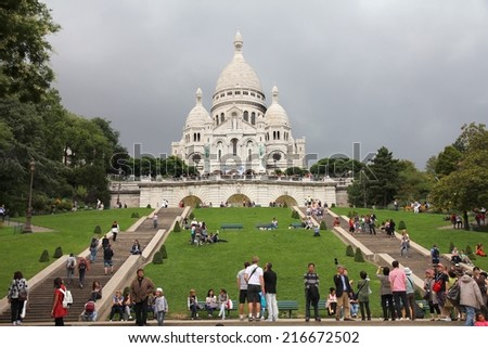 PARIS, FRANCE - JULY 22, 2011: Tourists stroll in Montmartre district in Paris, France. Paris is the most visited city in the world with 15.6 million international arrivals in 2011. - stock photo