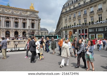 PARIS, FRANCE - JULY 22, 2011: Tourists visit Opera Garnier in Paris, France. Paris is the most visited city in the world with 15.6 million international arrivals in 2011. - stock photo