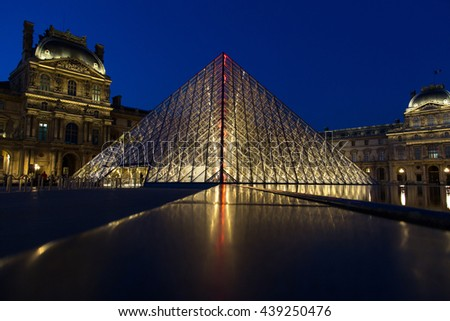 PARIS, FRANCE - JUN 18, 2014: Famous Louvre Museum Pyramid made of glass in Paris France on Jun 18, 2014. -