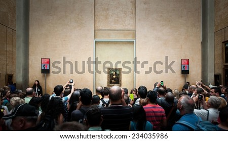 """PARIS, FRANCE - JUNE 18 , 2014 : A many of visitors take photos of """"Mona Lisa"""" , by Leonardo DaVinci's  at the Louvre Museum, june 18, 2014 in Paris, France. - stock photo"""